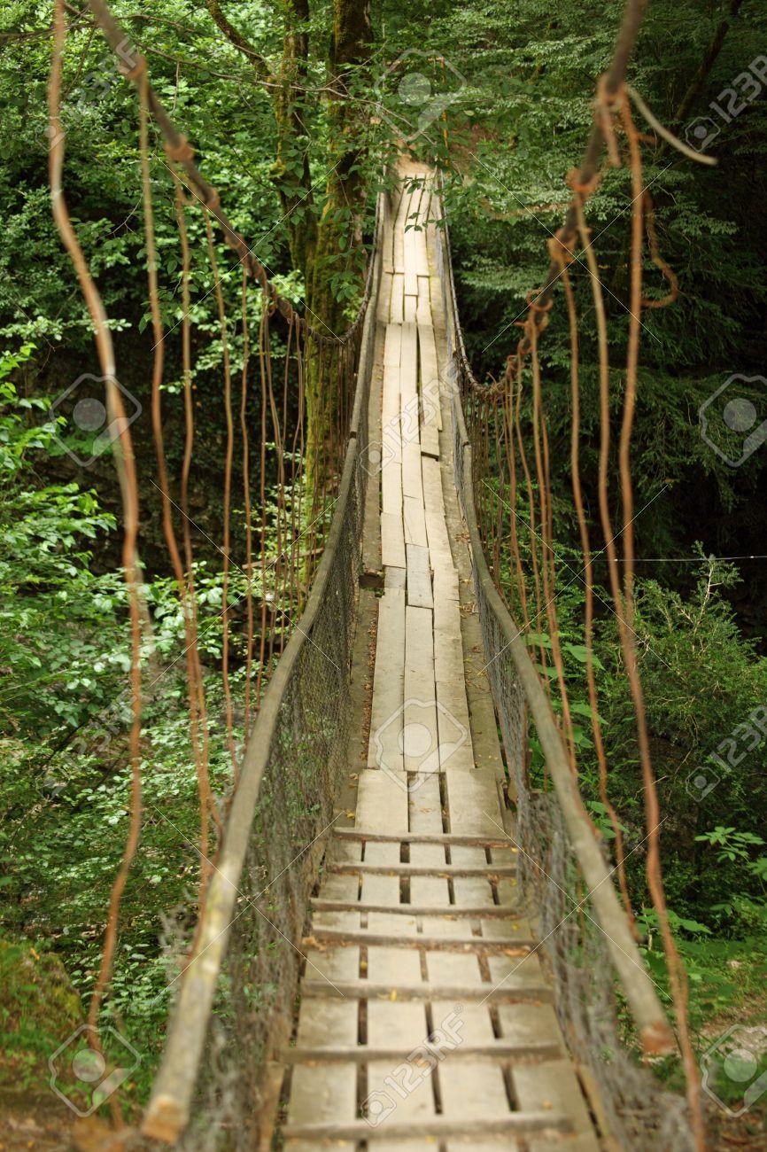 11373668-wooden-suspension-bridge-in-wood